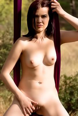 Lolly J Totally naked brunette swings in the forest